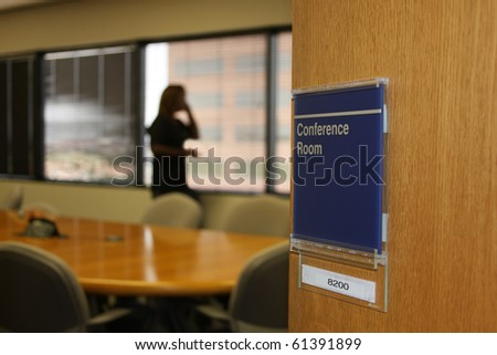 lady on phone in conference room at corporate office