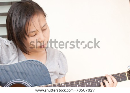 Lady playing classic acoustic guitar.