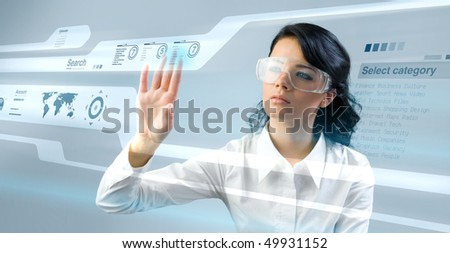 Lady press touch interface in virtual space. Future business technology series. (outstanding business people in interiors / interfaces series)