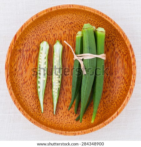 Lady \'s Fingers or Okra clean and healthy food on white table .