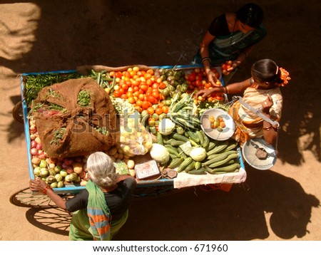 lady selling her vegetables on her ambulant stall
