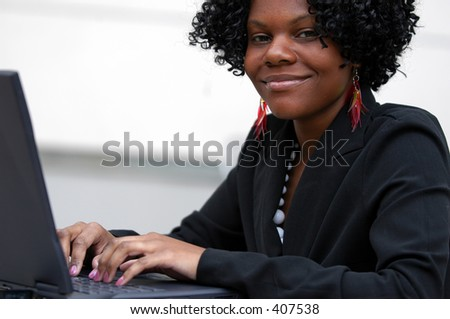 Lady smiles as see types on the computer