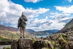 Lady standing at Llyn Gwynant in Snowdonia National Park Gwynedd North Wales - UK