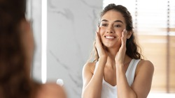 Lady Touching Face With Perfect Smooth Skin Standing In Bathroom