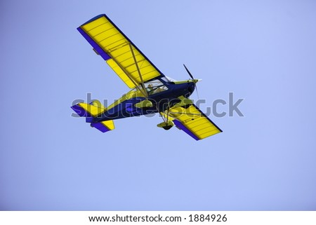 Lady visable in the cocpit of a light aircraft.