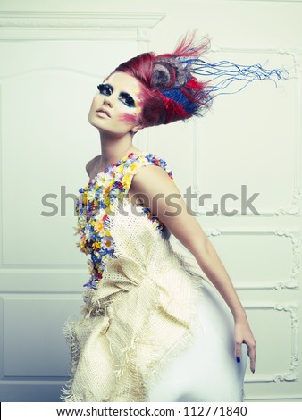 lady with avant garde hair and bright make up avant garde