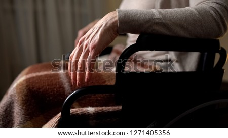 Lady with disabilities quietly sitting in wheelchair, sedative pills effect