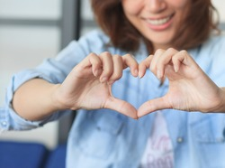 Lady with her hands in heart-shaped