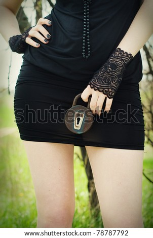 Lady with lock. Conceptual photography