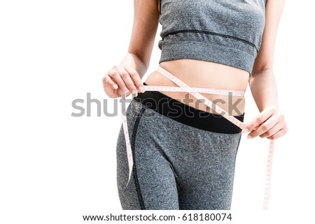 lady woman girl trying to measure waist circumference on white background, with clipping path #618180074