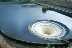 Ladybower Reservoir is the lowest of three reservoirs in the Upper Derwent . Bellmouth overflows (locally named the