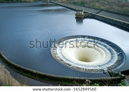 """Photo of  Ladybower Reservoir is the lowest of three reservoirs in the Upper Derwent . Bellmouth overflows (locally named the """"plugholes"""") at the side of the wall."""