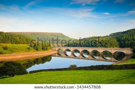 Photo of  Ladybower Reservoir, Peak District, Derbyshire, UK. The bridge across the Ladybower reservoir taken on a sunny day during the summer.