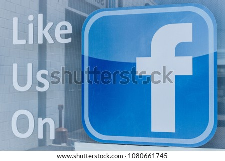 Lafayette - Circa April 2018: Facebook logo asking for likes outside a business. Facebook has been under scrutiny for their data and privacy issues I