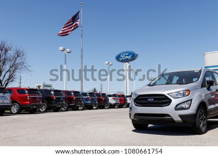 Lafayette - Circa April 2018: Local Ford Car and Truck Dealership with American flag. Ford sells products under the Lincoln and Motorcraft brands XII