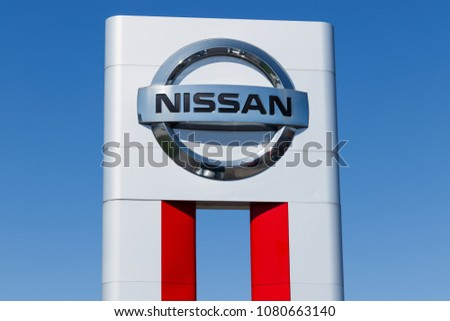 Lafayette - Circa April 2018: Logo and Signage of a Nissan Car and SUV Dealership. Nissan is part of the RenaultNissan Alliance I
