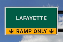 Lafayette logo. Lafayette lettering on a road sign. Signpost at entrance to Lafayette, USA. Green pointer in American style. Road sign in the United States of America. Sky in background