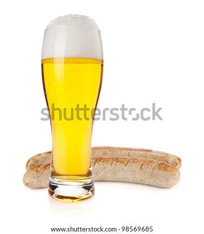 Lager beer glass and two grilled sausages. Isolated on white background