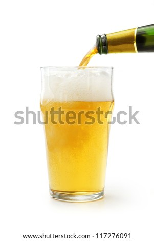 lager beer poured into a glass on white background