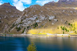 Lago di Fedaya. Magnificent lake at the foot of Mount Marmolada. Italy, Dolomites, Fedaya pass. Travel to the land of lakes and mountains