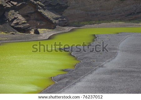 Lago Verde, a half-moon-shaped lagoon of a striking green colour at El Golfo in Lanzarote. Lanzarote , is one of the Canary Islands, in the Atlantic Ocean, appr. 125 km off the coast of Africa.