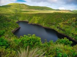Lagoa Comprida in Flores Island, Azores Archipelago, Portugal. Blue lake with green vegetation