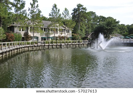 Lagoon and fountain by a resort building.  The resort is on Hilton Head Island in South Carolina.