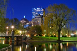 Lagoon Bridge and skyline of Boston, Massachusetts from the Boston Public Gardens.