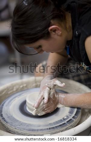 LAGUNA BEACH, CA AUG 31, 2008:  A potter works on a bowl on a potter\'s wheel at the Annual Laguna Beach Sawdust Art Festival.  Focus is on the wheel.