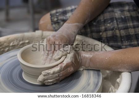 LAGUNA BEACH, CA AUG 31, 2008:  A potter works on a bowl on a potter\'s wheel at the Annual Laguna Beach Sawdust Art Festival.