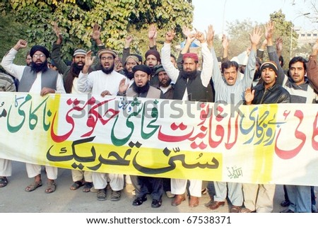 LAHORE, PAKISTAN - DEC 19: Activists of Sunni Tehreek chant slogans against price- hiking and in favor of their demands during a demonstration at Lahore press club on December 19, 2010 in Lahore.