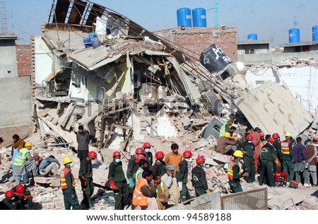 LAHORE, PAKISTAN - FEB 07: Rescue workers busy in rescue operation during the second day at the site of building collapse incident on February 07, 2012 in Lahore.