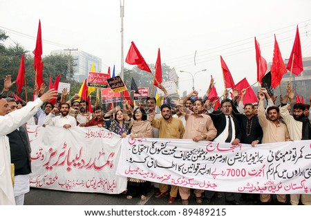 LAHORE, PAKISTAN - NOV 24: Supporters of Trade Union Federation (APTUF) shout slogans in favor of their demands during protest demonstration on Thursday, November 24, 2011in Lahore, Pakistan.