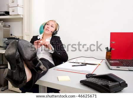 Laid back receptionist taking a call not too seriously