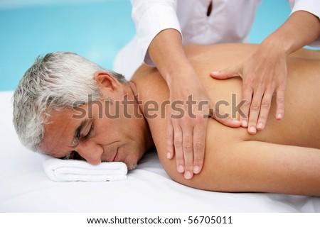 Laid man being massaged