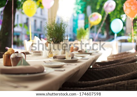 Laid table in a restoraunt with birthday baloons