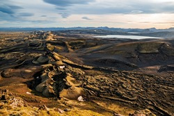 Lakagigar volcanic fissure at sunset illuminated by golden light, Iceland