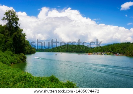 Lake activities, boating,marina seen from a moving train traveling through the Nantahala National forest. #1485094472