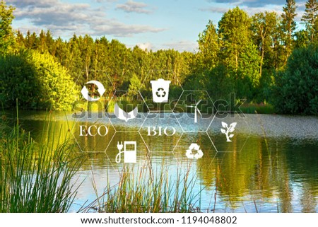 lake among the trees in the park on a summer day and the symbols of ecology and signs #1194048802