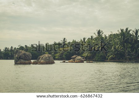 lake and boulders in the...