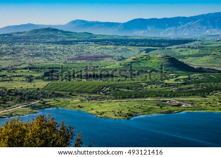 Lake and conic hill at Golan Heights #493121416