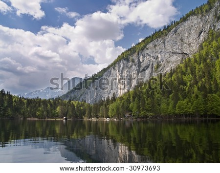 Lake and rocky mountain wall