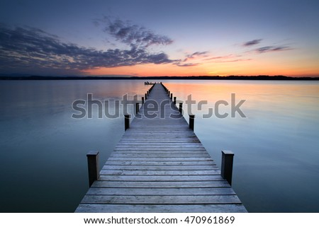 lake at sunset  long wooden pier