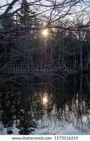 Lake at twilight time. Twilight lakeside scenery. Lake Kussharo, Hokkaido, Japan.