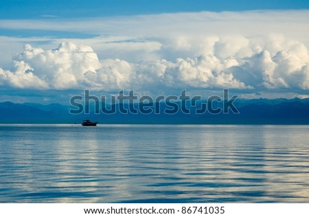 Lake Baikal,the ship against mountains and clouds #86741035