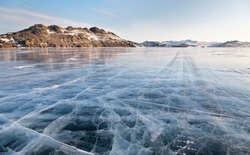 Lake Baikal. Winter morning. Ice road on Olkhon island