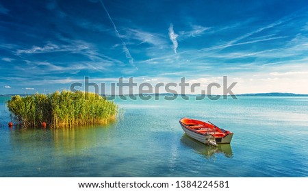 Lake Balaton with a red boat on a sunny day Stock photo ©