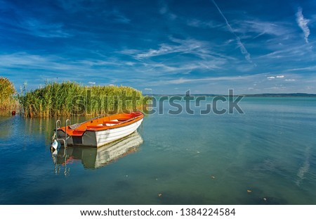 Lake Balaton with a red boat on a sunny day #1384224584