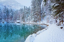 Lake Blausee in Bernese Highlands during winter, Switzerland