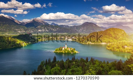 Lake Bled Slovenia. Beautiful mountain lake with small Pilgrimage Church. Most famous Slovenian lake and island Bled with Pilgrimage Church of the Assumption of Maria. Bled, Slovenia, Europe.  #1270370590